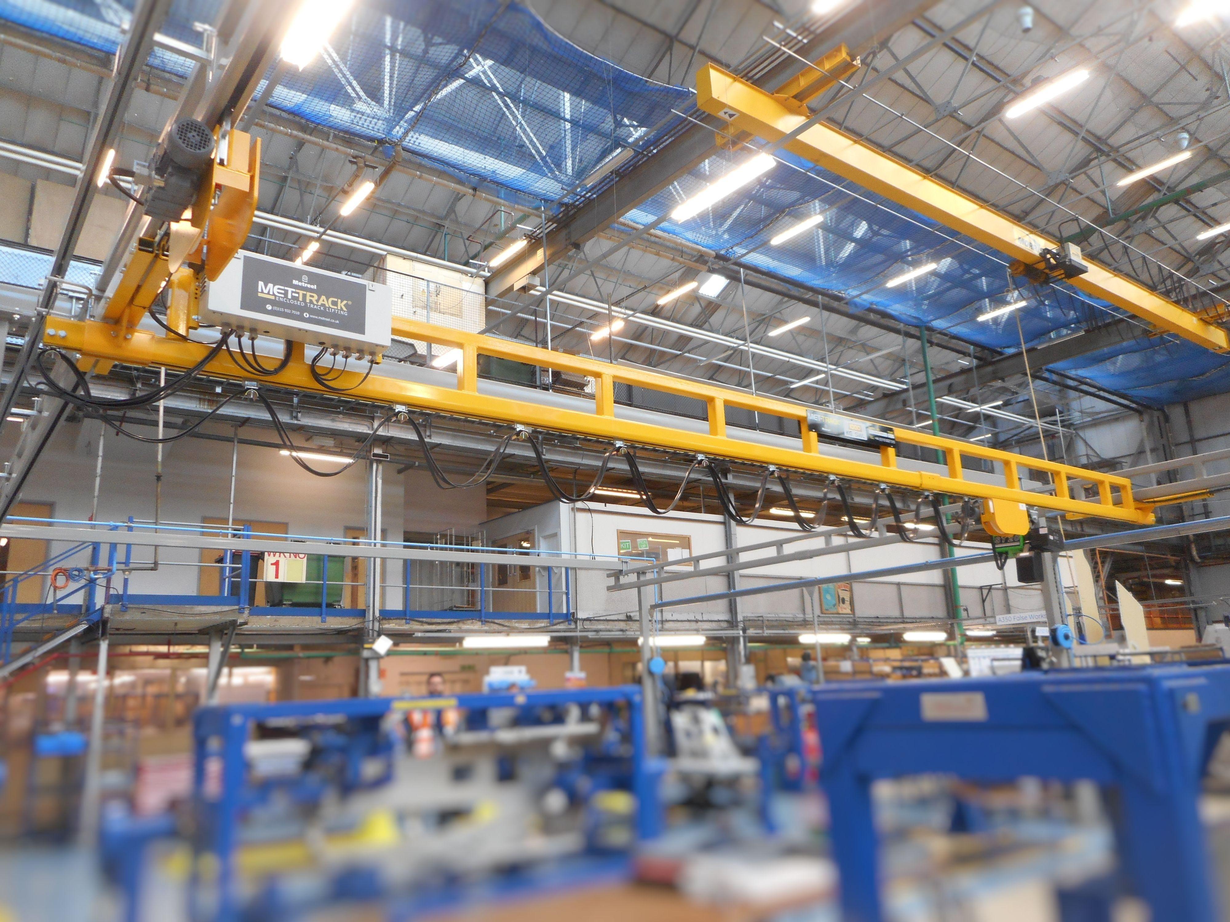 MET-TRACK Tractor Drives installed on a workstation bridge crane