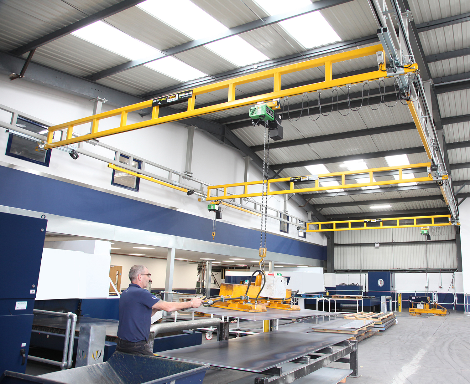 MET-TRACK Ceiling mounted workstation crane with multiple bridges